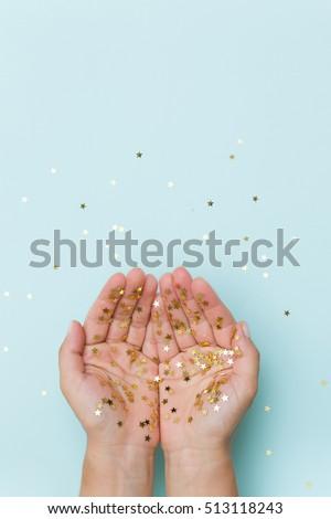 gold handing shiny glitter glowing star isolated on blue night background vector illustration stock photo © olehsvetiukha