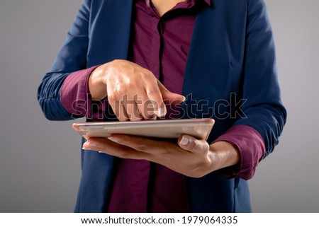 Mid section of young female executive working on digital tablet while sitting at the table in a mode Stock photo © wavebreak_media