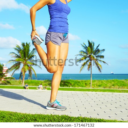 Young woman stretching during sport training outdoor on a winter day Stock photo © Kzenon