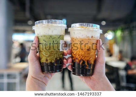 Bubble boba tea with milk and homemade tapioca and matcha pearls Stock photo © joannawnuk