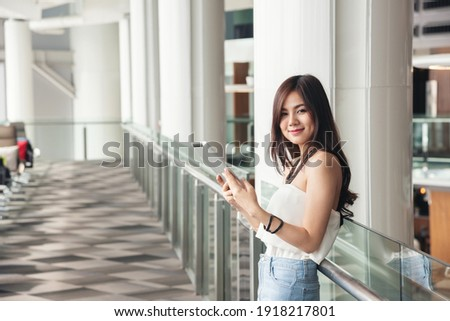Young Asian successful businesswoman in blue jeans and pullover sitting in cafe Stock photo © pressmaster