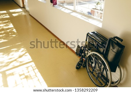 Front view of empty wheelchair against wall in corridor at retirement home Stock photo © wavebreak_media