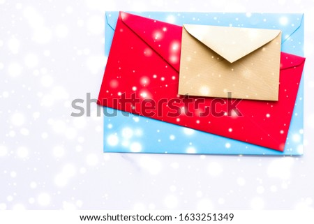 Winter holiday blank paper envelopes on marble with shiny snow f Stock photo © Anneleven