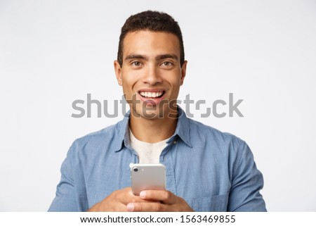 Cheerful smiling and enthusiastic handsome guy got matched with gorgeous girl on dating app, look ca Stock photo © benzoix