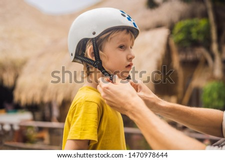 Trainer helps the boy to wear helmet before training skate board BANNER, LONG FORMAT Stock photo © galitskaya