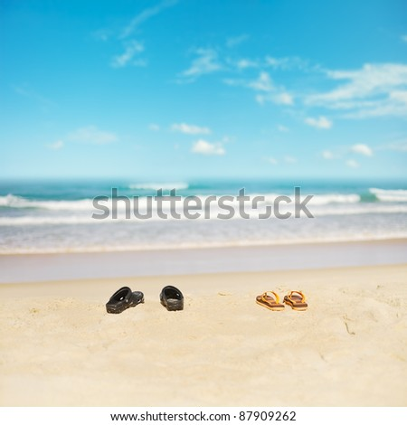 Two pairs of shoes on a sand of the tropical beach. Shallow dept Stock photo © moses