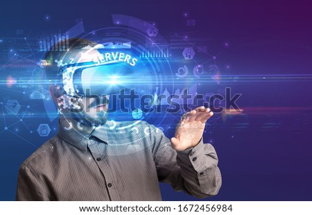 Businessman looking through Virtual Reality glasses, tech concept Stock photo © ra2studio