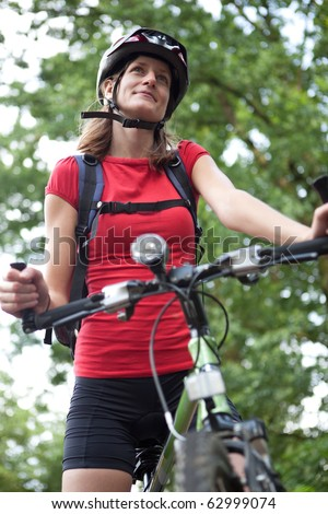 pretty young female biker outddors on her mountain bike (shallow Stock photo © lightpoet