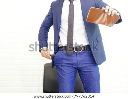 Adam takım elbise bakıyor boş cüzdan beyaz adam Stok fotoğraf © wavebreak_media