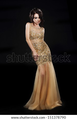 Vogue. Beautiful Fashion Model In Golden-Yellow Dress over Black Stock photo © gromovataya