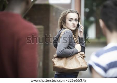 teenage girl using phone as she feels intimidated on walk home stock photo © highwaystarz