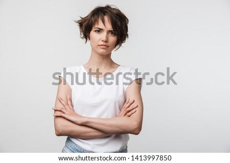 Frowning casual woman looking at camera Stock photo © wavebreak_media