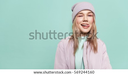Cheerful happy young woman in casual clothes and pink sunglasses  Stock photo © deandrobot