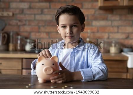 teenage boy with piggy money box stock photo © simply