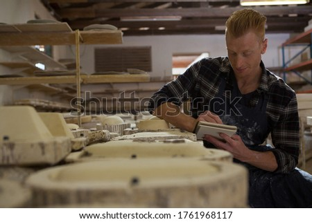 Male potter writing on a diary Stock photo © wavebreak_media
