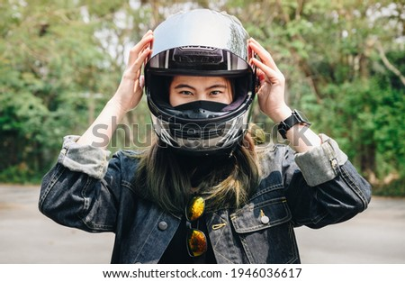 Young lady before a motorbike journey Stock photo © konradbak