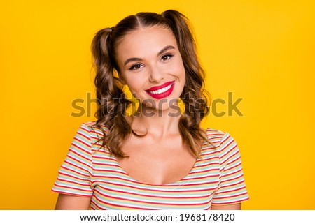 Girl with red pigtails on a yellow background. A charming girl in round transparent glasses raised h Stock photo © Traimak