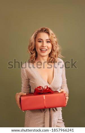 Young blonde girl in red short  dress holding isolated on white Stock photo © Elnur