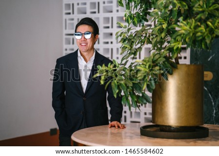 portrait of relaxed businessman wearing navy suit and blue tie Stock photo © feedough