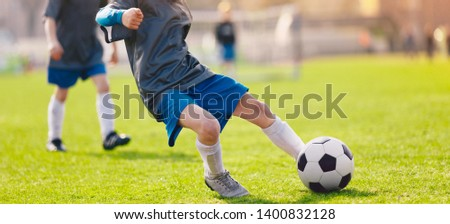 Boys Playing Soccer Game. Soccer Kick Moment. Junior Player Shoo stock photo © matimix