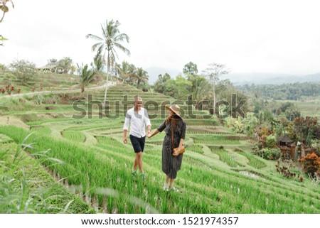 Young woman on Green cascade rice field plantation at Tegalalang terrace. Bali, Indonesia with sunli stock photo © galitskaya