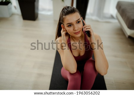 photo of healthy woman doing stretching exercises while standin stock photo © deandrobot