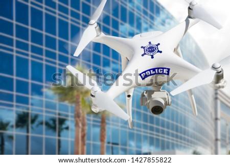 Rendőrség repülőgép repülés város toronyház épület Stock fotó © feverpitch