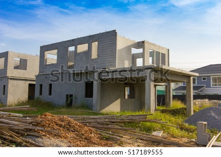 Contractor In Front New House Wood Framing at Construction Site Stock photo © feverpitch