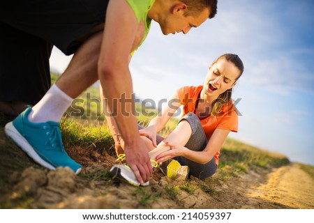 Injury - sports woman with twisted sprained getting help from ma Stock photo © Lopolo