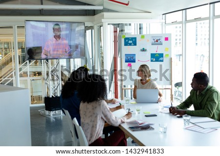 Front view of diverse business people attending a business seminar in a conference room. with black  Stock photo © wavebreak_media