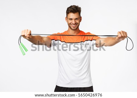 Handsome energized fitness instructor giving jump rope, instruct how lead active and healthy lifesty Stock photo © benzoix