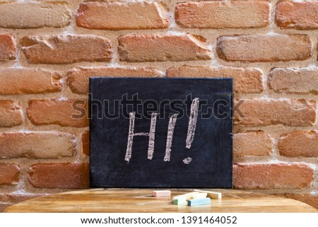 Black board with the word HI! drown by hand on wooden table on b Stock photo © marylooo
