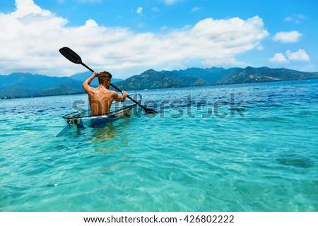 Summer travel kayaking. Man paddling canoe kayak enjoying recrea Stock photo © dashapetrenko