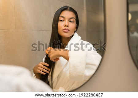 Reflection of young brunette female in white bathrobe drawing heart on mirror Stock photo © pressmaster