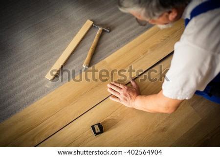 Közelkép férfi kezek padló parketta csináld magad Stock fotó © lightpoet