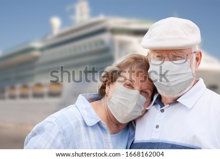Senior Couple Wearing Face Masks Standing In Front of Passenger  Stock photo © feverpitch