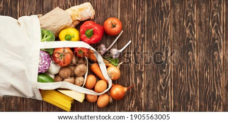 Different vegetables in reusable bags on wooden background. Zero waste concept Stock photo © galitskaya