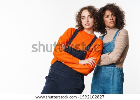 Portrait of confused multinational women looking at camera Stock photo © deandrobot