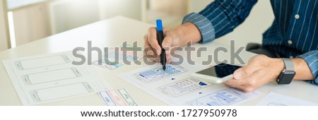 ux designer creative planning application development near layou Stock photo © snowing