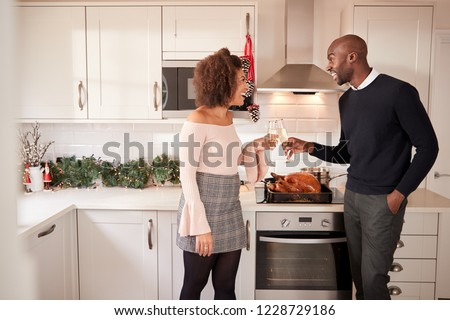 The young couple preparing for christmas meal Stock photo © Elnur