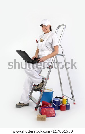 portrait of female painter decorator with laptop leaning against ladder Stock photo © photography33