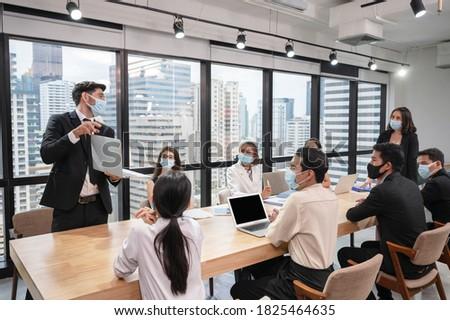 Caucasian businessman presenting  Stock photo © wavebreak_media