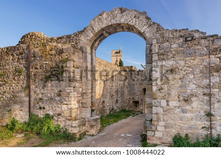 ancient stone gate arch medieval town castle san gimignano tusca stock photo © billperry