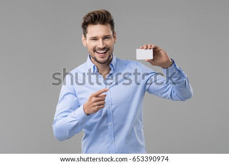 Happy smiling business man showing blank businesscard and dreami Stock photo © HASLOO