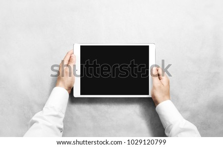 Businessman hold smart touch pad screen for presentation somethi stock photo © hin255