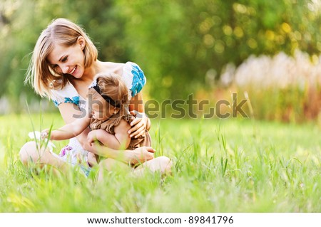 Mother with a daughter on a grass Stock photo © Paha_L
