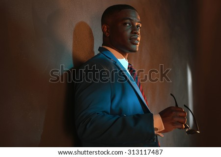 Handsome businessman in black suglasses holding colorful water gun Stock photo © deandrobot