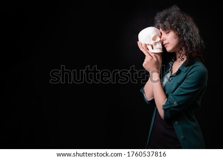Girl in black halloween costume with eyes closed holding balloons Stock photo © deandrobot