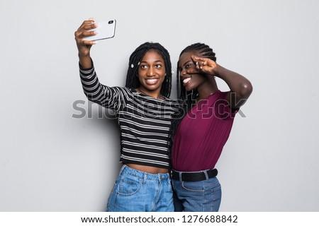 Beautiful executive taking selfie from mobile phone Stock photo © wavebreak_media