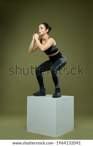 sportswoman doing squats on cube Stock photo © LightFieldStudios